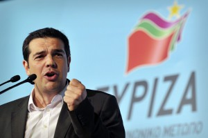 Left Coalition Party leader, Alexis Tsipras gestures while addressing his supporters, during party's main pre-election rally in central Athens Omonia square on May 3, 2012. The slogan reads' Turnout in Greece-message to Europe'.  Crunch elections in Greece on May 6 may not produce a government with a strong enough mandate to push through yet more austerity cuts to satisfy Athens' international creditors. Sunday's election is expected to see Greek voters, many of them fed up with grinding austerity drives, vote for parties that say they would scrap deals with the EU and IMF.  AFP PHOTO / LOUISA GOULIAMAKI        (Photo credit should read LOUISA GOULIAMAKI/AFP/GettyImages)